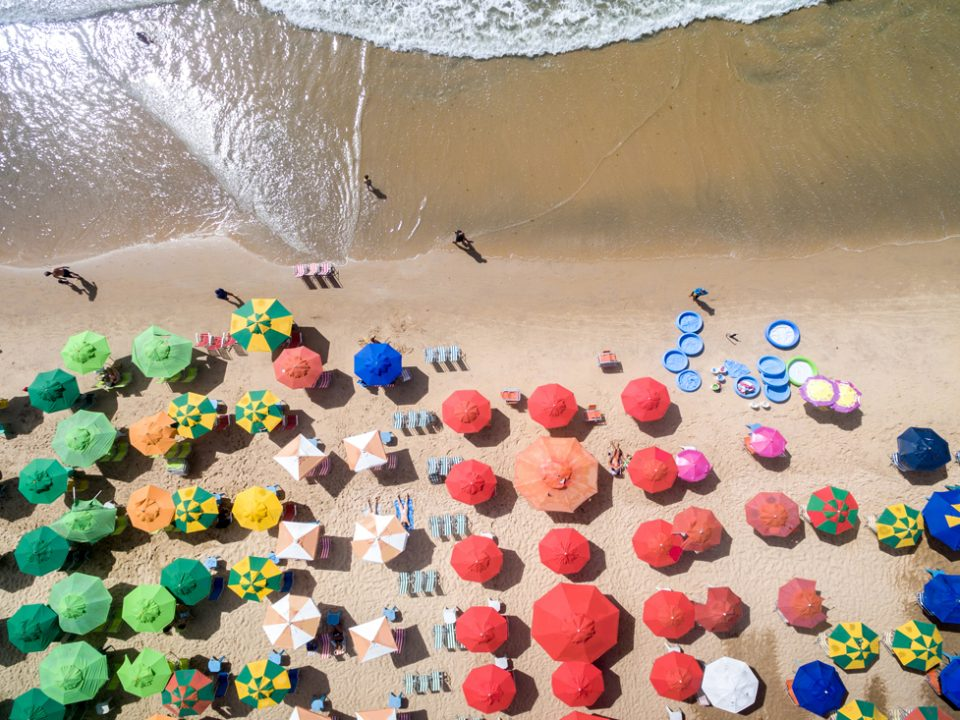 stock-photo-top-view-of-umbrellas-in-a-beach-405036466