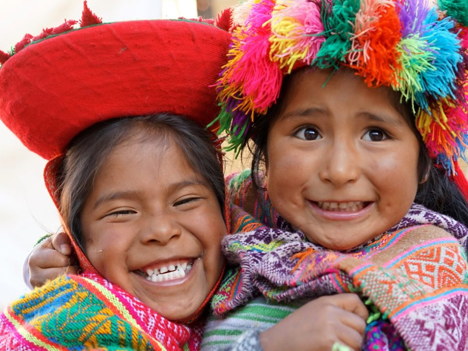 stock-photo-young-inca-sisters-playing-in-sunday-market-cuzco-peru-659821519